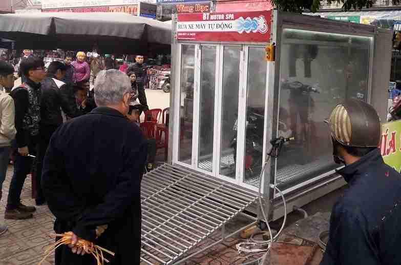 Hệ thống rửa xe máy tự động tại khu chợ truyền thống